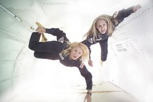Allison Odyssey and Debbie McMahon <br> experience zero gravity aboard G-FORCE ONE