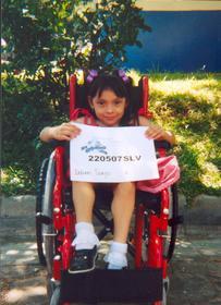 Wheelchair recipient on behalf of Wellness International Network
