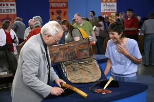 At ANTIQUES ROADSHOW in Baltimore, Maryland, appraiser Doug Diehl of Skinner examines four unique American Indian artifacts, valued at $130,000 to $200,000.