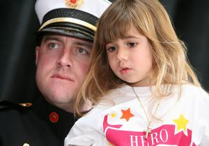 Local firefighter Zak Jones of North Naples, Fla. and Marissa Napoleoni, a YMCA pre-school student, took part in opening ceremonies honoring the heroes of today and tomorrow at the Naples Winter Wine Festival.