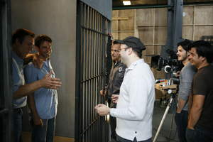 L-r: Robert Davi, Steven Man, James Russo talk with Director Rolfe Kanefsky, Director of Photography Gigi Malavasi and 1st Assistant Camera operator, Richard Amador  on the set of ONE IN THE GUN.