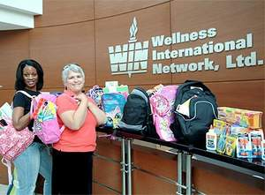 Wellness International Network employees Vonetta Fleming and Jeanette Camp gathered and delivered dozens of donated backpacks and school supplies to Rainbow Days, an organization that supports high risk children in the Dallas Metroplex.