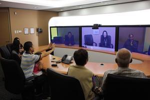 The Savedras Reunite via Cisco TelePresence
