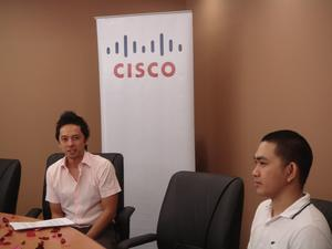 Tep Misa (left) and Jason Villegas (right) in the Cisco Philippines TelePresence Suite