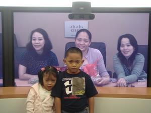 Hassel Lanza (center) and family in a virtual family portrait