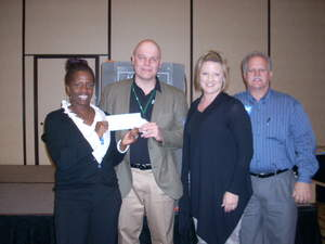 Ed Reilly, ECRM VP of Grocery, presents $5,000 check to representatives of the Boys & Girls Clubs of Greater Dallas.