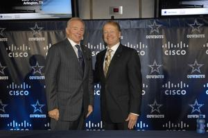 Cisco CEO John Chambers and Dallas Cowboys owner Jerry Jones shake hands at a press conference at the new Dallas Cowboys Stadium to announce the Cisco technology deployment.