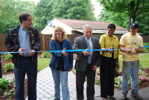 The Electric Insurance Company Home Makeover culminated with a ribbon-cutting ceremony.  Included from left to right are Marc Meiches, President and CEO of Electric Insurance; Cherie Gouthro, Home Makeover recipient; William Scanlon, Jr., Beverly, MA. Mayor; Denise Durham Williams, Executive Director, One Family, Inc.; and Bob Lessard, Team Lead for CITE.