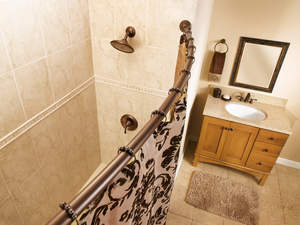 Adding hotel luxury and style to your bathroom is easy with a Curved Shower Rod and new Shower Curtain Roller Rings from Moen.