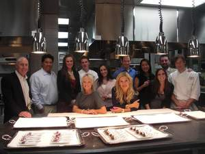 Total Experience Specialists in Guy Savoy's Caesars Palace kitchen with Guy Savoy team members.