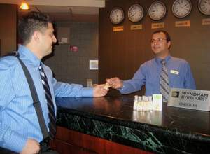 Wyndham guest receives hand sanitizer at check-in.