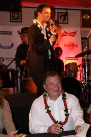 Brian Evans croons while William Shatner appears before him.