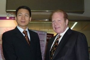 Pictured Left to Right:  Luo Jianhui, Vice President and Chairman, Unisoft Group, Unis-Tonghe Technology, and Robert H. Lorsch, Chairman and CEO, MMR Information Systems, Inc., in China.