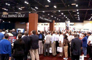 Full Swing Golf Simulator entertains a crowd at the 2010 PGA Merchandise Show.