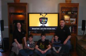 RedEye Fan Jolt winner Kammy Markey and family with their new home theater from ThinkFlood