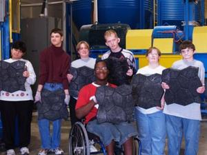 Students from Texas School for Deaf Hold Landscaping Pavers made from e-Waste Plastic