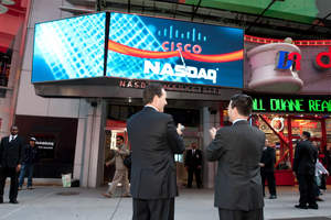 Cisco SVP Marthin De Beer and NASDAQ SVP Robert McCooey celebrate the new marquee in Times Square, powered by Cisco