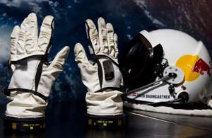 Felix Baumgartner's full pressure suit gloves and helmet for the Red Bull Stratos project.