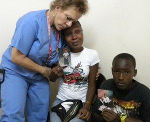 Wellness International Network physician volunteers medical aid to Hatian survivors.