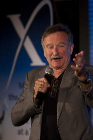 Academy Award winner, Robin Williams encourages bids from guests.