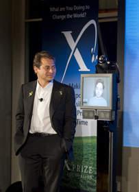 Peter Diamadis talking with Sergey Brin via teleoperated robot.