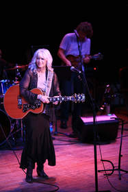 Emmylou Harris plays with Sam Bush and an unprecedented group of artists for NRDC's 'Music Saves Mountains' Concert at The Ryman in Nashville, TN.