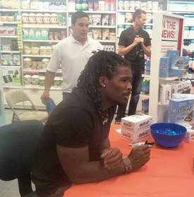 Carolina Panthers' star running back DeAngelo Williams answers questions and signs autographs at GNC in the SouthPark Mall while promoting ISS Research's OhYeah!(R).