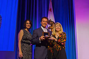California Governor Arnold Schwarzenegger and Secreteary of Service and Volunteering Karen Baker Present Cisco and Meg Taylor with the 2010 'Medal for Service for the Business Volunteer Program of the Year'