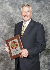 Longfellow Benefits principal and cofounder Craig Cerretani with Best Places to Work 2010 award