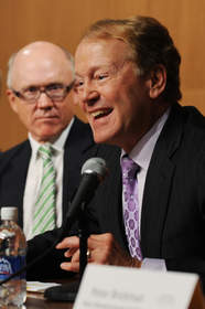 EAST RUTHERFORD, NJ - AUGUST 23: John T. Chambers of Cisco speaks as New York Jets owner Woody Johnson and Ivan Seidenberg, CEO, Verizon listen during a press conference at New Meadowlands Stadium on August 23, 2010 in East Rutherford, New Jersey. The press conference was held to introduce new technologies that enable stadium transformation to uniquely host New York Jets and New York Giants games in addition to other entertainment events in the venue.