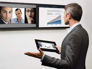 Executive uses Avaya Flare as a controller for multiparty videoconference using Avaya Videoconferencing Solutions endpoints.