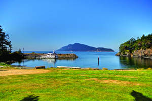 The island offers a protected harbor, rock breakwater, pier, metal ramp and a floating dock