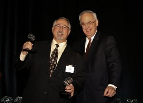 MSI's CFO, Ron Warren receives awards from HBJ's John Beddow