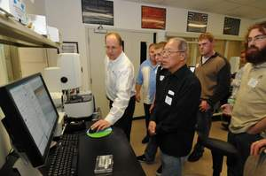 Dr. John Ireland, Director of the NanoProfessor Nanoscience Education Program, demonstrates the hands-on nature of NanoInk's NLP 2000 to College of Lake County and Harper College students.
