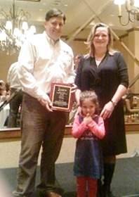 Matt Larsen accepts WISP Operator of the Year award from WISPA President Elizabeth Bowles