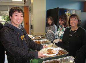 RCC International Student Minsok Kwen enjoying Thanksgiving luncheon sponsored by NY Credit Union