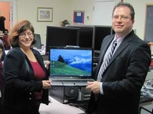 Robert Lodato presenting computers to Joanne Sappo of The Sappo School