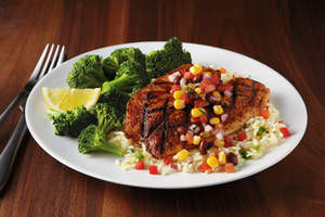 Cajun Lime Tilapia (Weight Watchers PointsPlus value: 8): A grilled Cajun-seasoned tilapia fillet topped with lime juice and black bean and corn salsa, served on a bed of rice pilaf with seasonal vegetables.