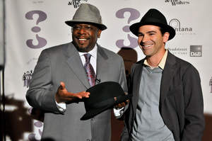 Cedric the Entertainer shows off his WHO CED? hat line with Dun & Bradstreet Credibility Corp. CEO Jeff Stibel in Las Vegas, NV.