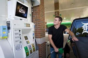 Gas Station TV, engaged consumer watches ESPN at the pump