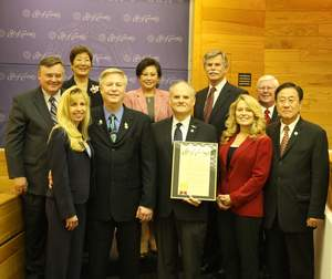 Millennium Dental Technologies, Inc. representatives and members of the Cerritos City Council.