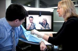 Professor Debra Nestel conducting a tutorial for Gippsland Medical School students via Cisco TelePresence.