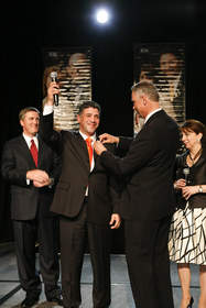 4Life Founder & CEO David Lisonbee pins Angel Molina, 4Life's newest Platinum International Diamond, at Powered By Platinums Event in Anaheim, California.