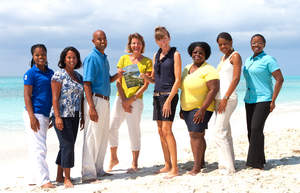 Photo of reservations team on beach in Turks and Caicos