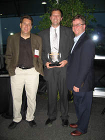 AtNetPlus Partner Jim Laber (center) is congratulated by CEO of PreEmptive Solutions, Gabriel Torok (Left) and Executive Director of NEOSA, Brad Nellis (Right) at the 2011 NEOSA Best of Tech Ceremony