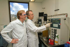 Hawaii Biotech CEO Elliot Parks and scientist David Clements at the lab in suburban Honolulu.