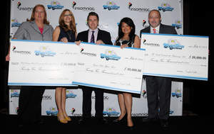 (Left to right) Cheryl Wagner and Paula Zier, administrators of Clark County School District's School-Community Partnership Program, Pasquale Rotella, CEO/Founder of Insomniac, Minddie Lloyd, Injured Police Officers Fund, and Myron Martin, President and CEO of The Smith Center for the Performing Arts, display the $25,000 donations from Electric Daisy Carnival Las Vegas ticket sales.