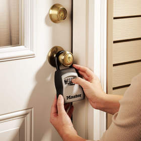 When you can't be there to let others in, utilize a key safe such as Master Lock's 5400D to allow your children and others you trust easy yet secure access to your home.