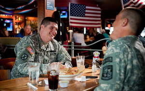 Two members of the Army enjoy a free meal at Applebee's, which will again feed veterans and active duty military on Veterans Day, Friday, November 11, 2011.