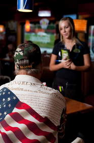 A veteran orders a free meal at Applebee's, which will provide free Thank You meals to veterans and active duty military on Veterans Day for the third consecutive year.